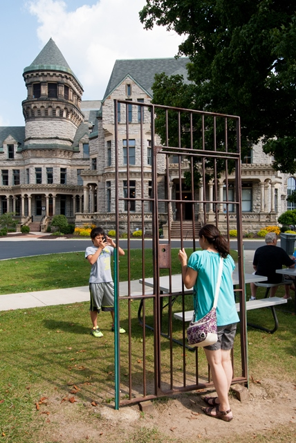 people taking photos outside reformatory