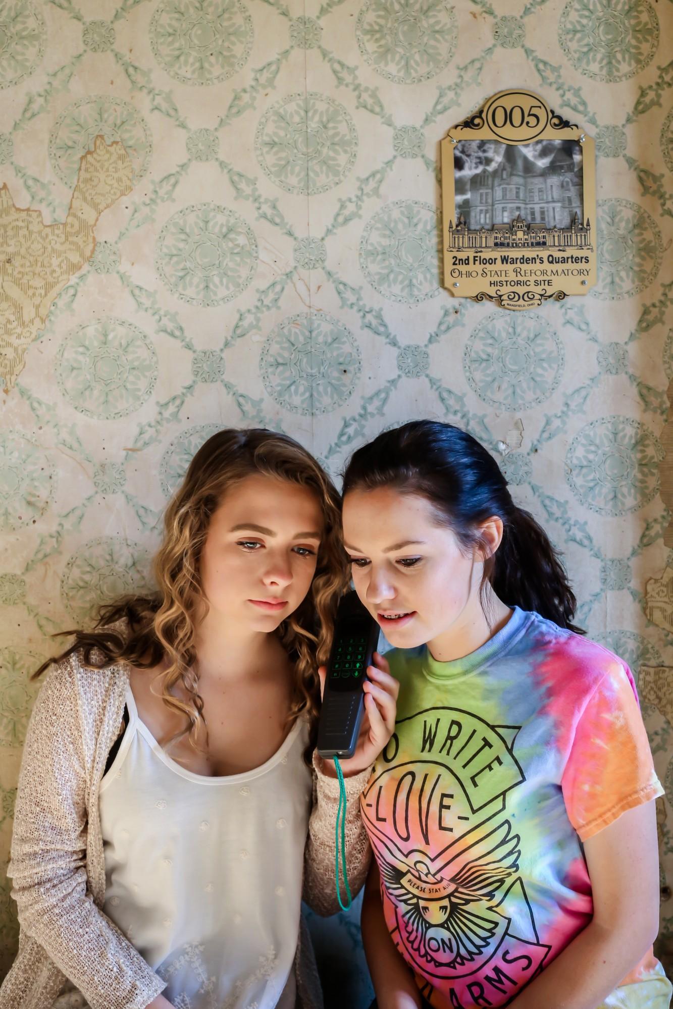 2 girls listen to audio tour